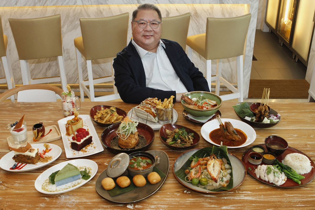 Mr Tang Wee Sung with the dishes that he had approved for Island Cafe, an eatery at Tangs.