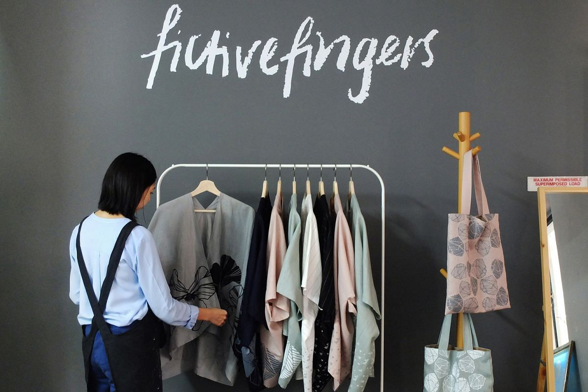 The designers at Fictive Fingers blend traditional methods like silkscreen and block printing with contemporary techniques in their work. Their studio in Geylang is one of the stops in this year's Design Trails event in which participants visit a sel