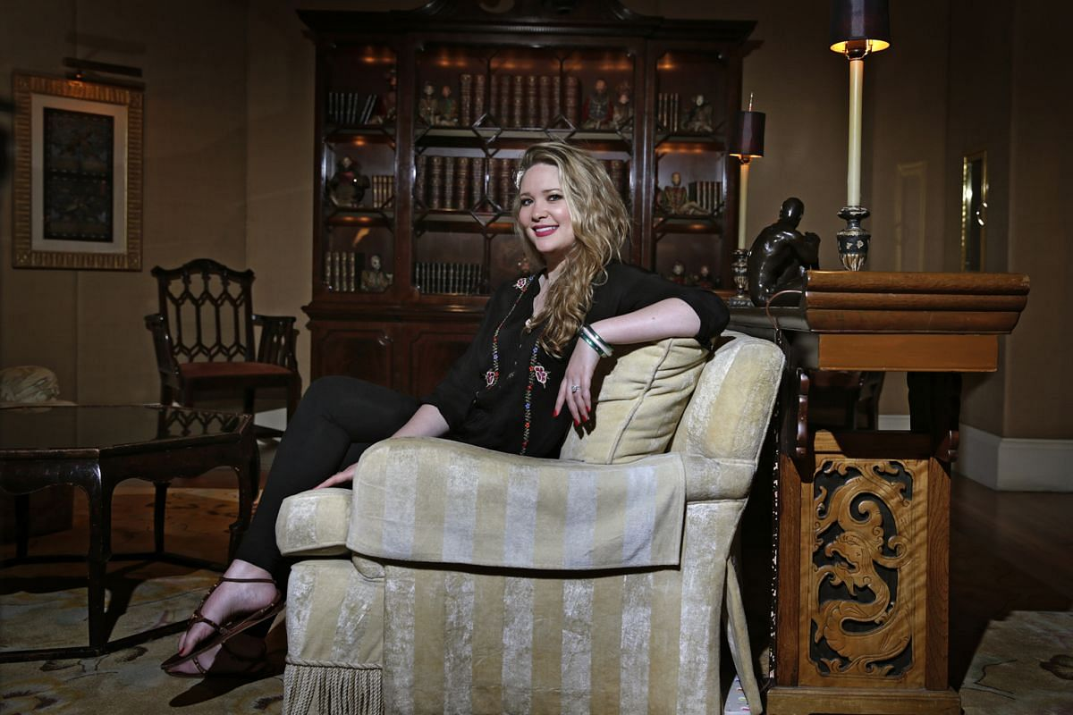 Young adult fiction writer Sarah J. Maas (above). A Court Of Thorns And Roses is inspired by Beauty And The Beast and Queen Of Shadows is the latest book in her Throne Of Glass series, which follows a teenage assassin.