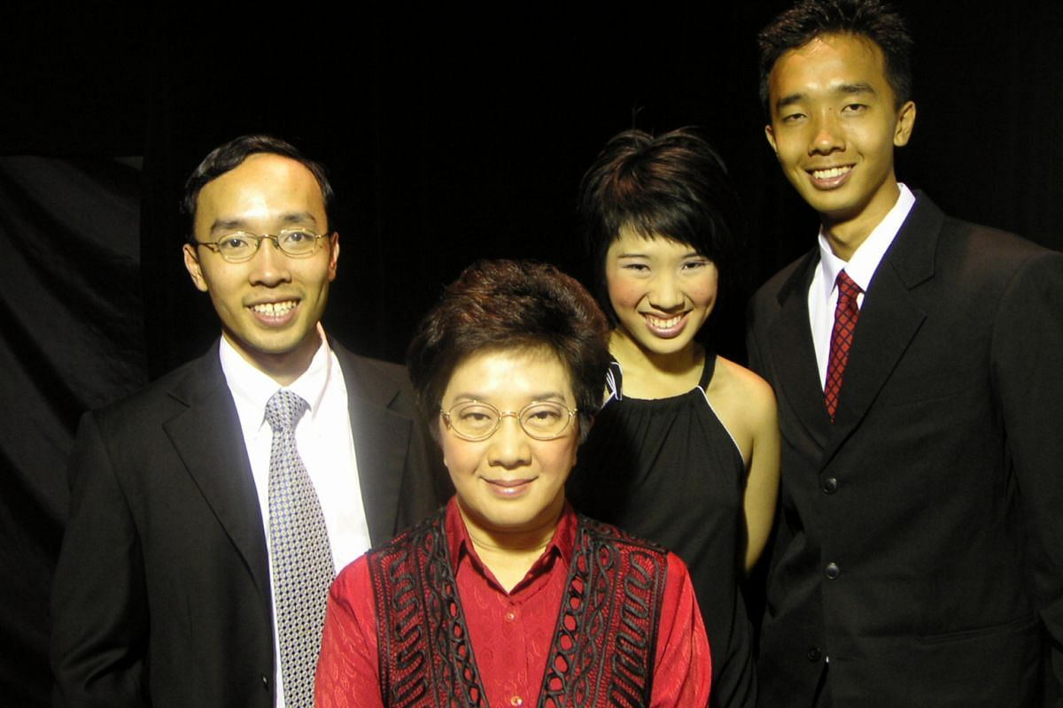 My life so far: Tham with her children (from far left) Danny, Jacinta and Ivan.