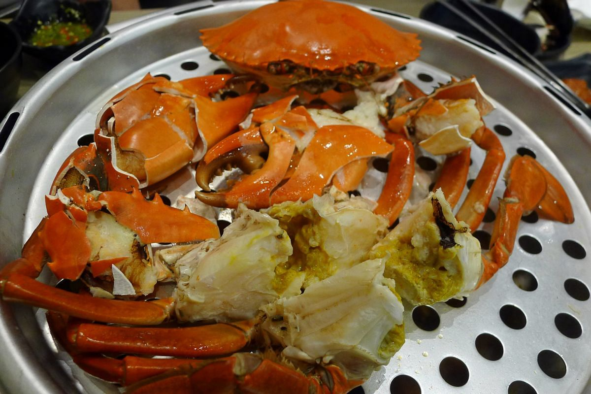 The live crab with rich golden roe (above) is best eaten without any sauce while the squid stuffed with flavoured rice benefits from a sauce.