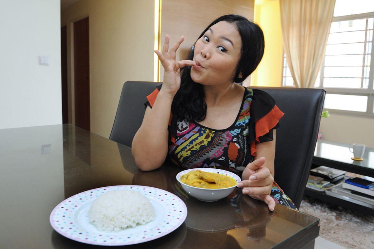 Siti Khalijah with her favourite dish - her mum's ayam lemak chilli padi.