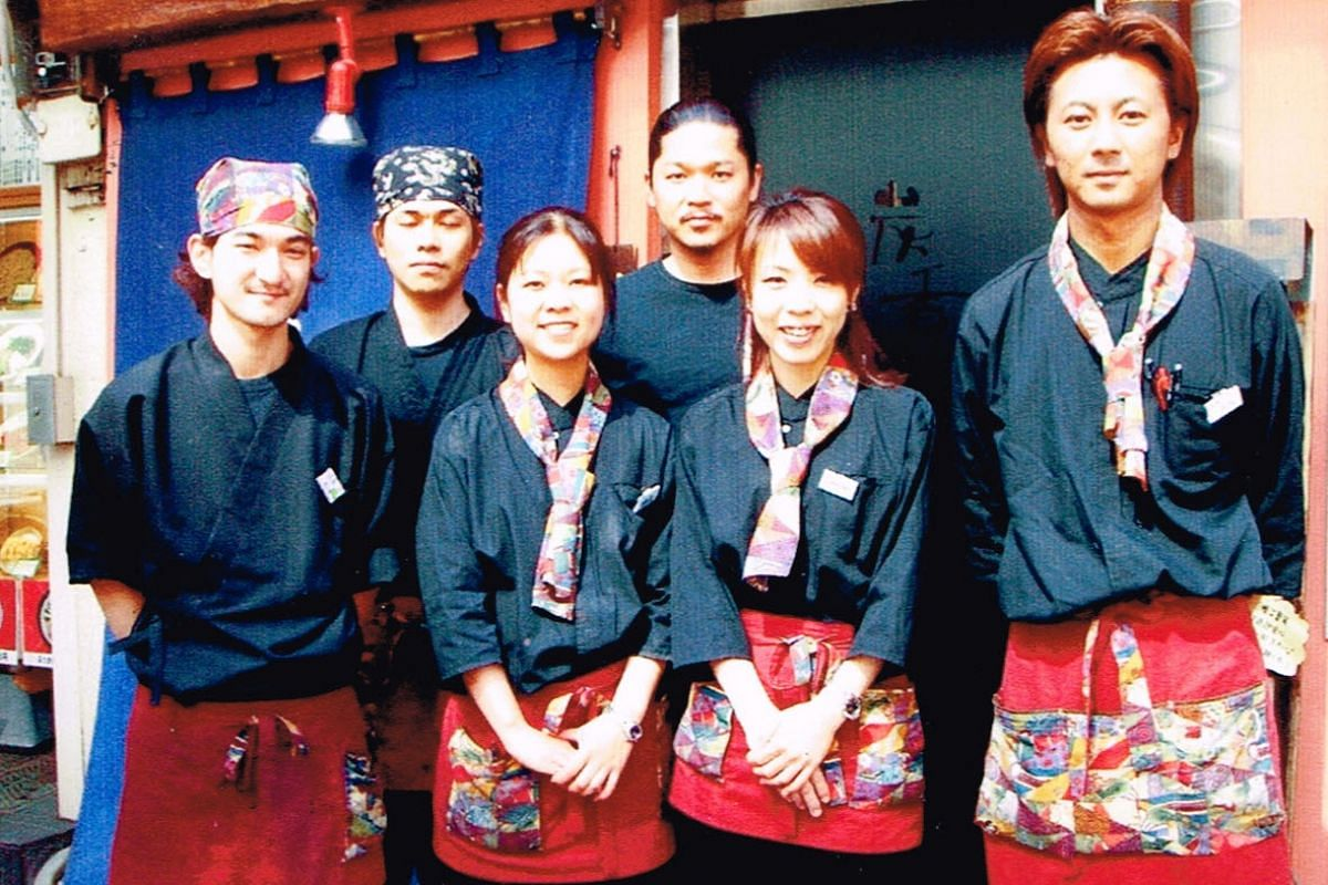 My life so far: Keisuke (centre) at the opening of his izakaya in Tokyo in 2003.