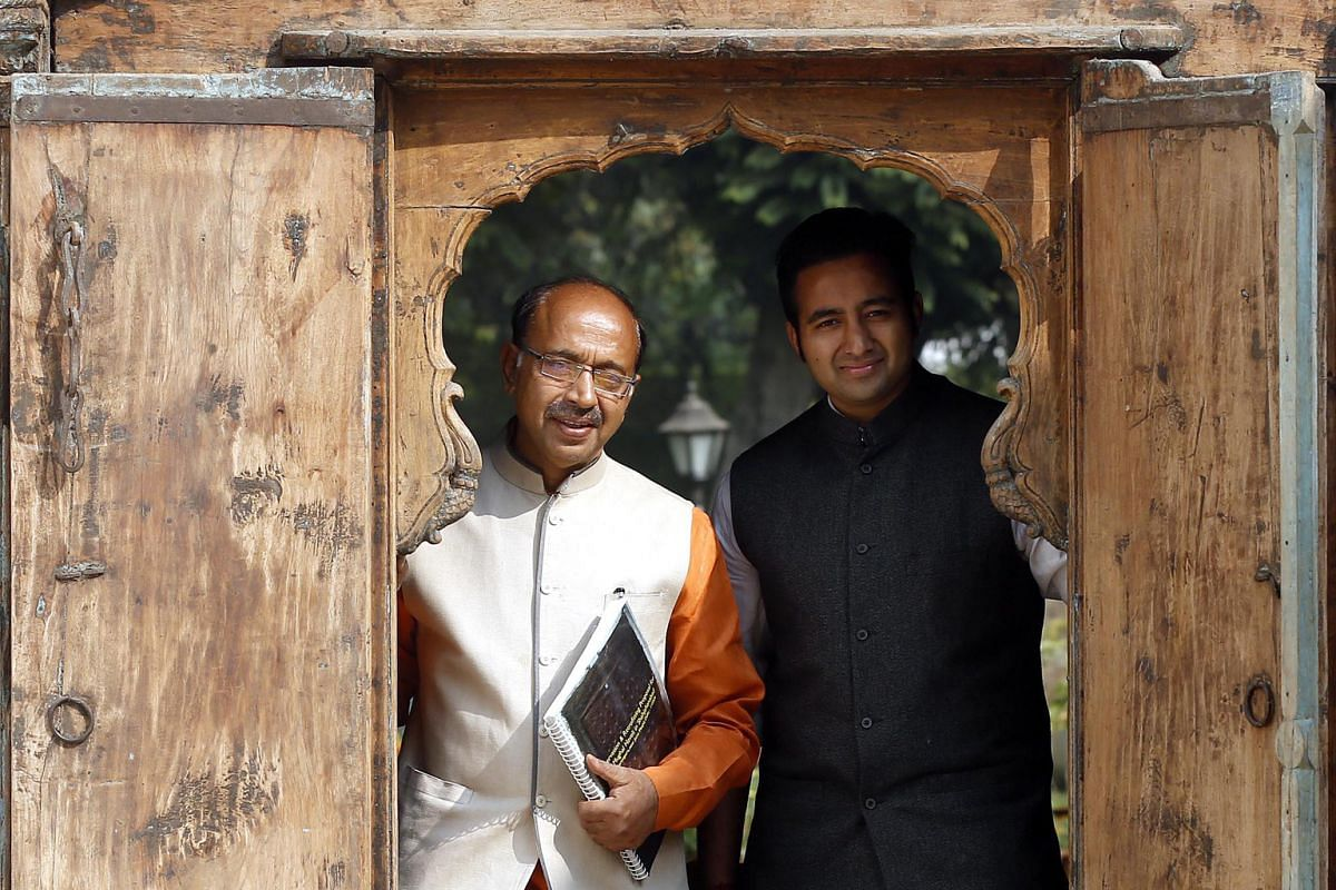 Mr Vijay Goel, who restored the haveli, with his son, Siddhant.