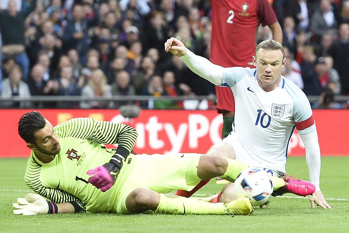 Portugal goalkeeper Rui Patricio saving a shot by Wayne Rooney during last week's international friendly. The best position for both the England captain and Dele Alli is at the front of the midfield diamond.