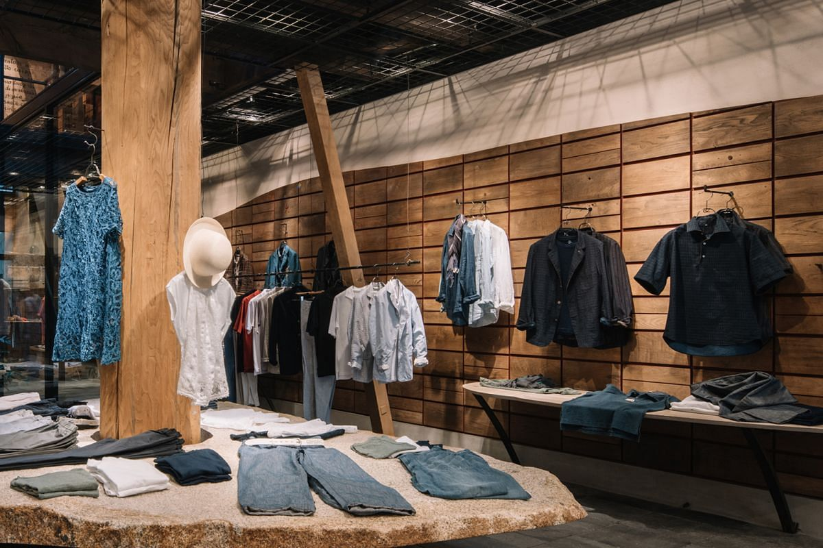 45R has designs that are hand- stitched and prints that are silk-screened or block-printed by hand. Mr Naoyuki Asai of Asai Roketsu washing a piece of clothing after it has been dipped into ai dye. His family-run factory dyes the clothes under 45R's