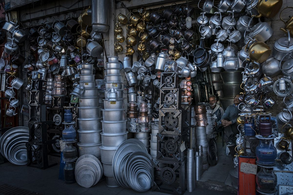 A shop filled to the rafters with pots and pans in Iran.