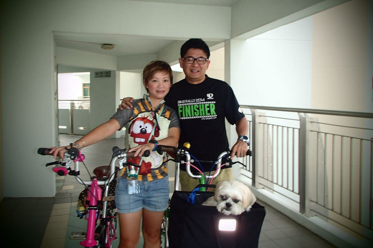 Designer Eugene Chua transports his children Chua Lin, 11, and Chua Yi, six, on a longtail bicycle and cycles on his foldable bicycle to work. Operations manager William Khaw and his wife Grace with their shih tzu, Kimchi. The couple enjoy cycling ou
