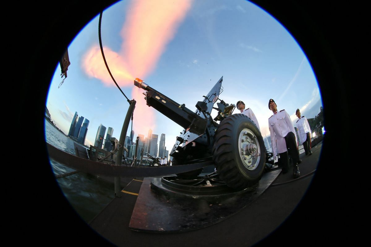 2: National servicemen firing a ceremonial gun at the National Day Parade National Education 2 show on July 21, 2012.