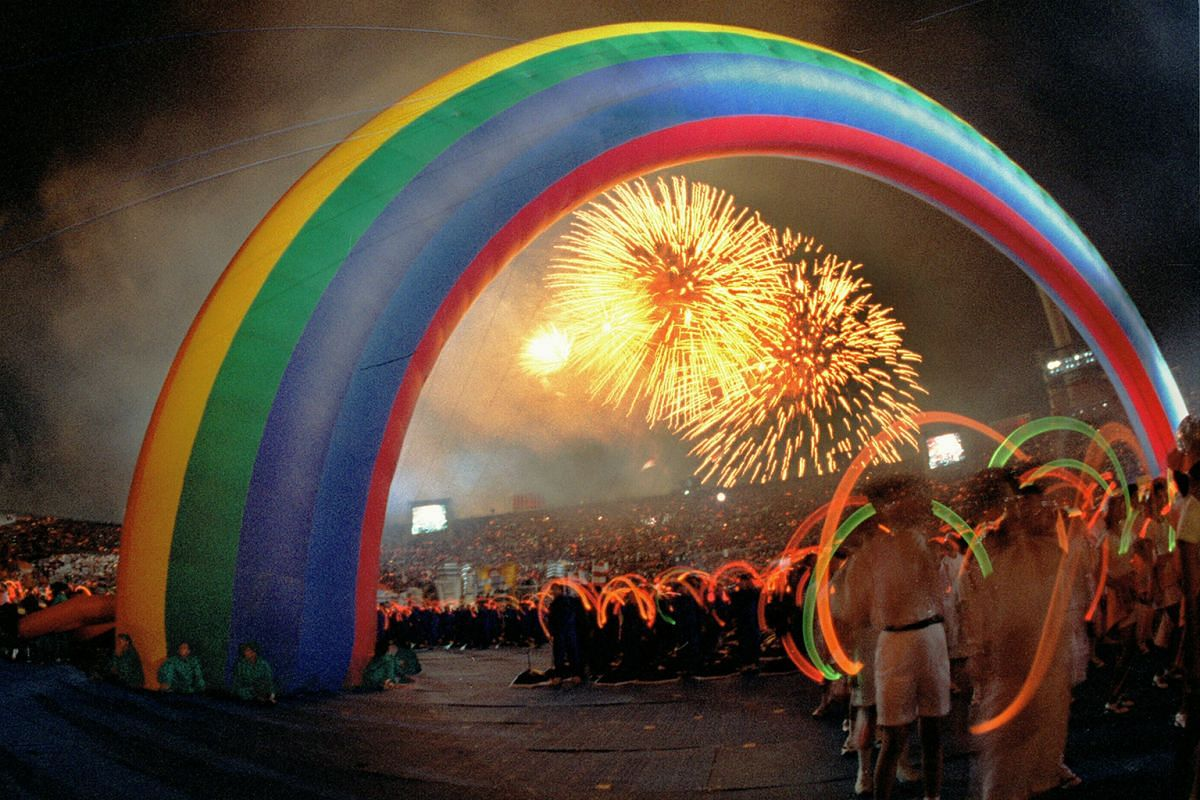 4: Wild cheers break out from the stands as the rainbow, the icon of the 1997 parade, forms an arch across the stadium in the finale of the show segment.