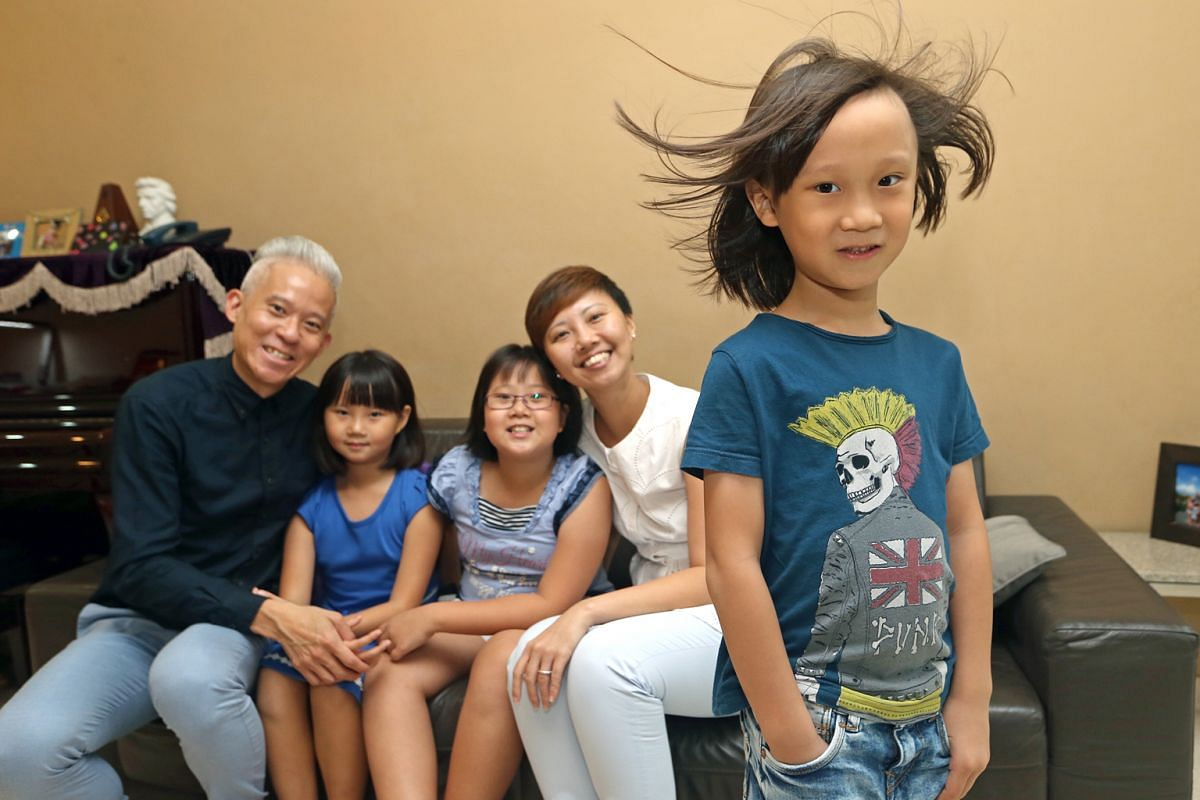 With his long, curly hair and large, manga eyes, Romir Vedi (above), 21/2, has an androgynous look. Lloyd Loh (left), six, with his family - (from far left) dad Richard Loh, sisters Laurel, eight, and Lauren, 10, and mum Celine Tan. Matthias Ong (lef