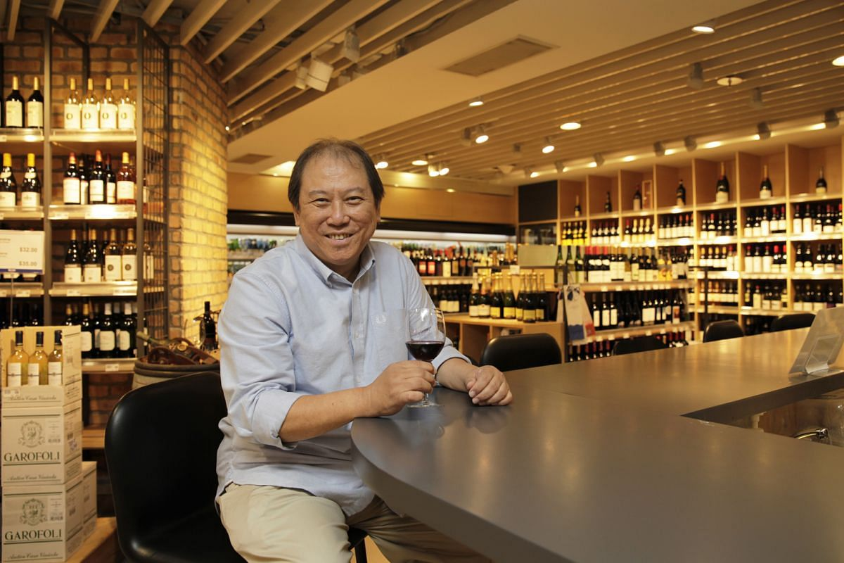 Mr Don Tay (above) at his Bacchus outlet in the Isetan department store at Westgate mall.