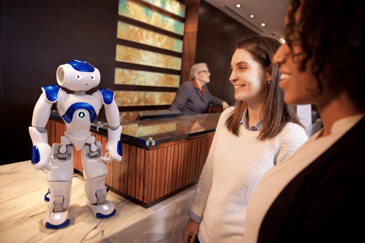 Hilton's Connie robot (above) can give restaurant recommendations. Scheduled to open in 2018, the Rosemont Hotel in Dubai promises a 75,000 sq ft rainforest (above, in an artist rendering) on its roof.