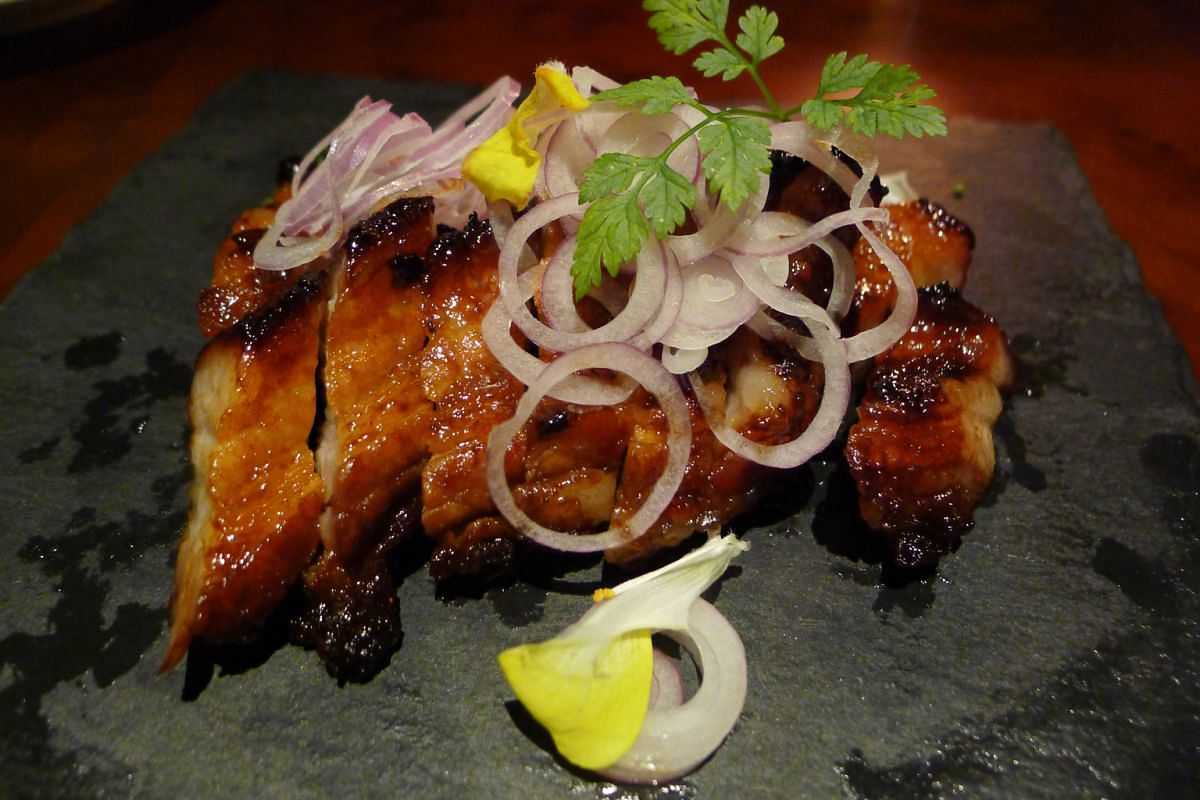"""Kagoshima Kurobuta """"Char Siew"""" (above) is juicy and the flavour of the Japanese pork wonderful, while the Poached Ocean Fish (left) is fresh and cooked just right."""