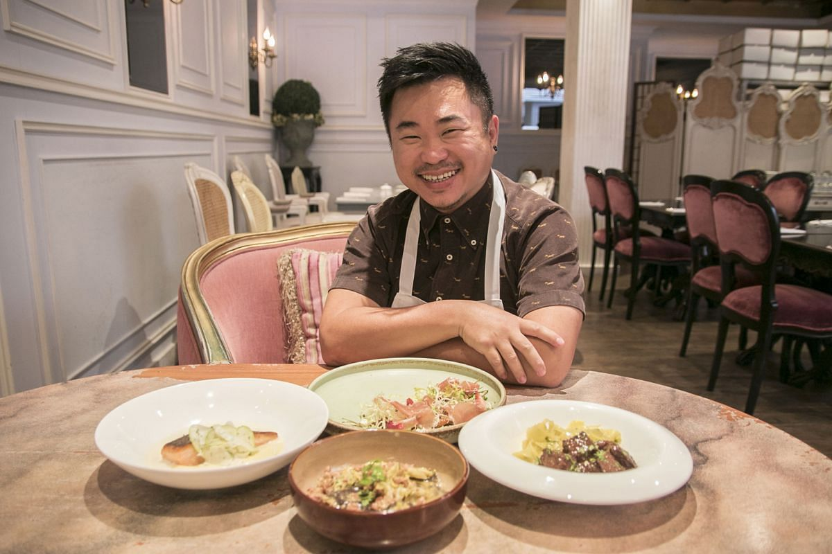 Antoinette's chef-owner Pang Kok Keong with the four savoury dishes that use Valrhona chocolate of different intensities in his Fetish Chocolat promotion.