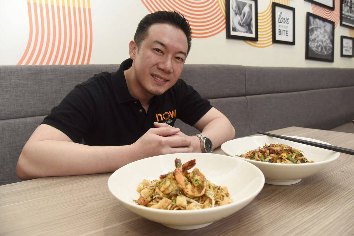 Doodles co-founder Desmond Tan with his shop's customisable cold noodles, which are served in a bag. Now Noodles+ director Kevin Khoo with the eatery's dry laksa and mee tai mak, which are cooked in an aromatic rempah made from scratch.