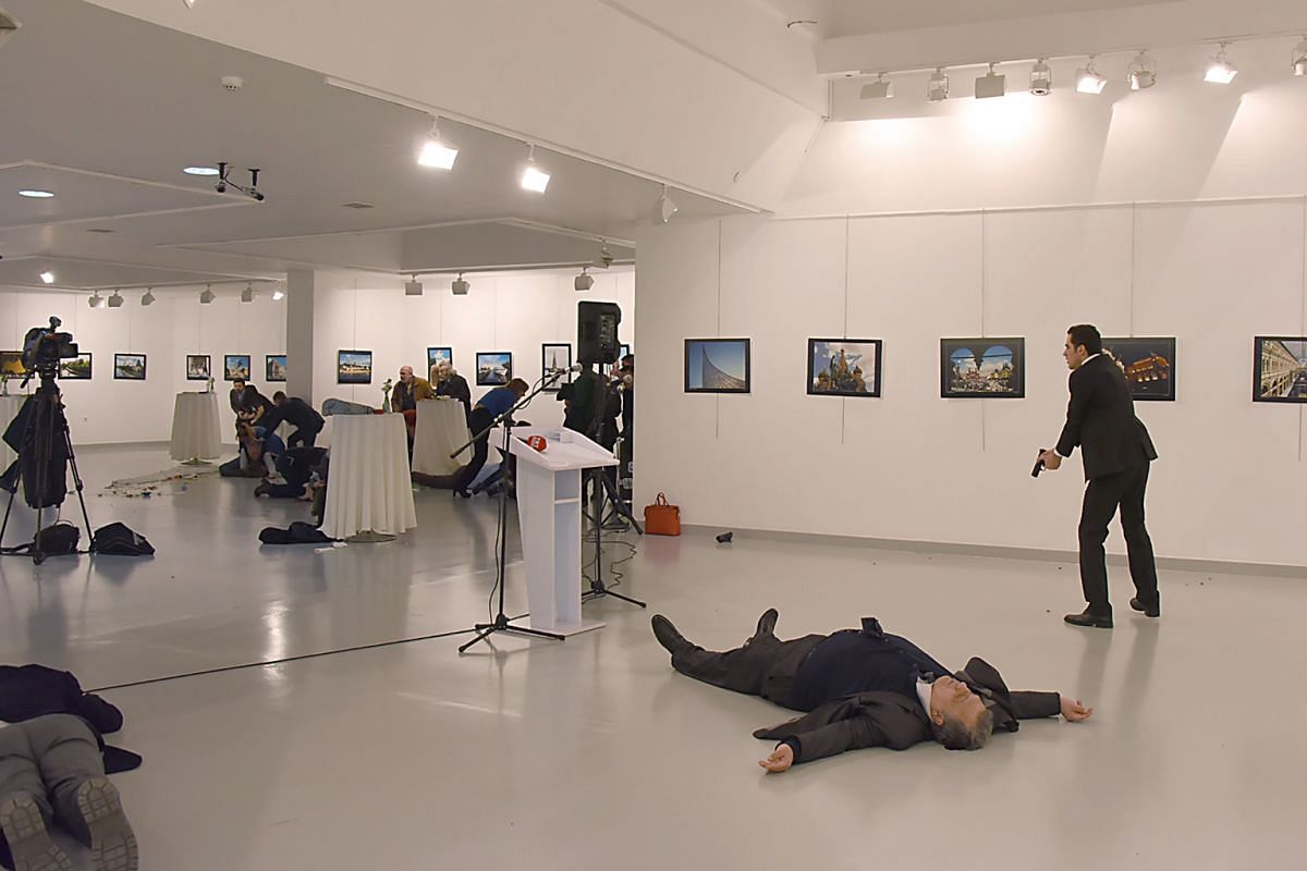Above: Last month, Russian Ambassador Andrei Karlov was assassinated during a reception in an Ankara art gallery.