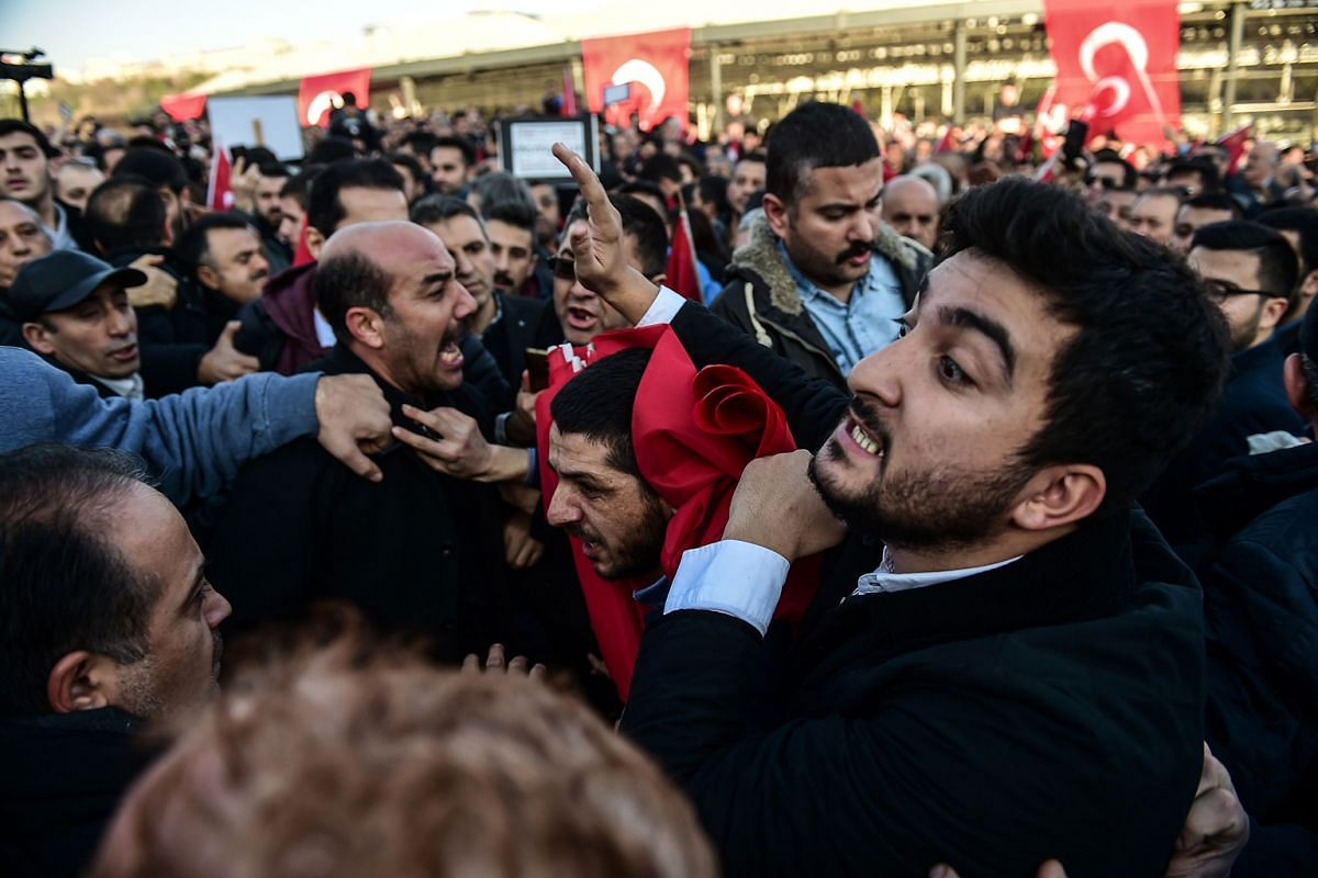 Pro-government supporters shouting at a vehicle carrying representatives of Turkey's main opposition People's Republic Party. The clash took place during a demonstration in response to terror attacks outside the Vodafone Arena in Istanbul. Last m