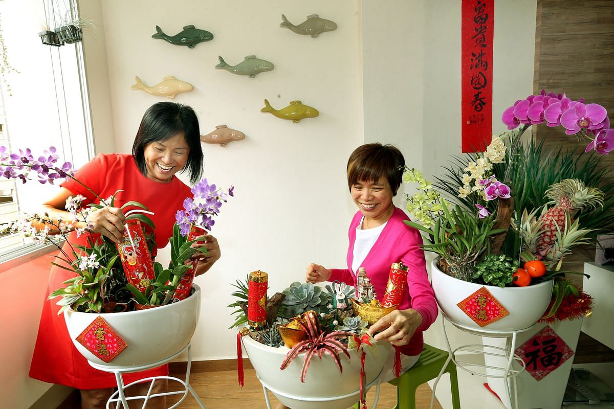 Housewife and avid trekker Iris Wee (right) and her sister Cheryl (left) have chosen a plant theme for their Chinese New Year decorations