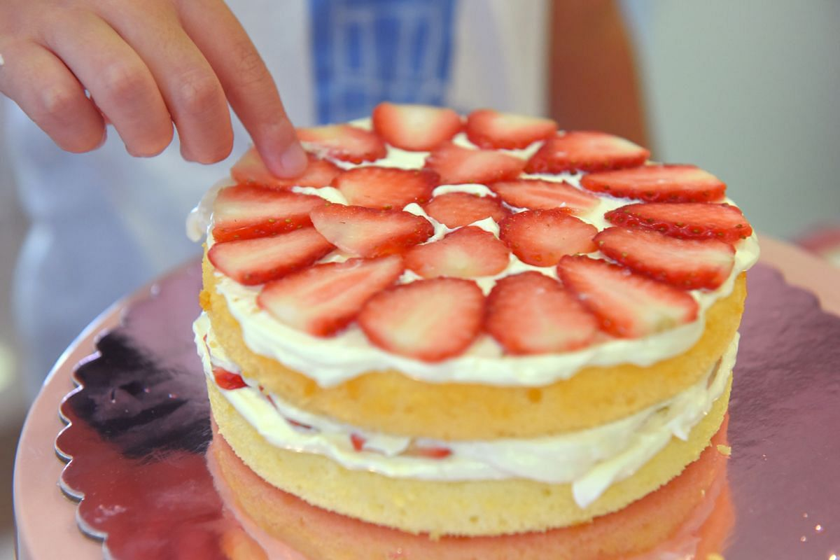 Ms Meg Tan's ombre strawberry shortcake features three layers of genoise sponge in a visually pleasing gradient of pastel yellow, orange and pink hues.