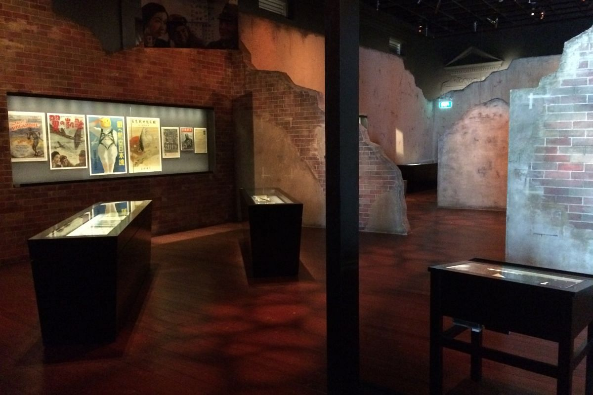 Facsimiles of crumbling walls evoke the atmosphere of wartime Singapore in the Surviving Syonan gallery.