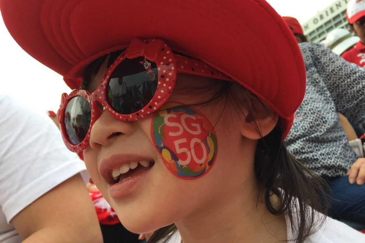 Three-year-old Evie Ong enjoys the pre-parade with her colored up sunglasses.