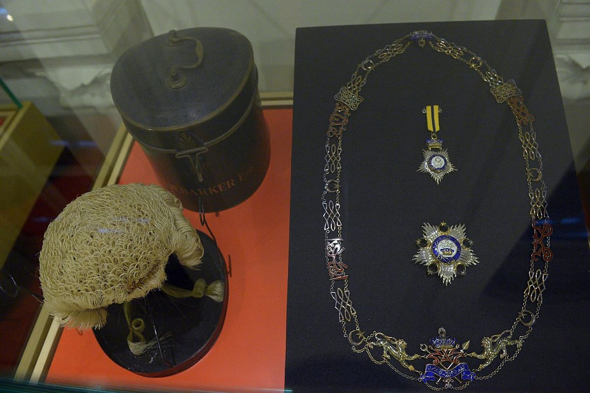 Singapore's first Law Minister Edmund William Barker's horsehair barrister wig (left). The Darjah Seri Paduka Mahkota Johor regalia (right) was bestowed on Mr Lee Kuan Yew and Mr Barker by Sultan Mahmood Iskandar of Johor in recognition of their cont
